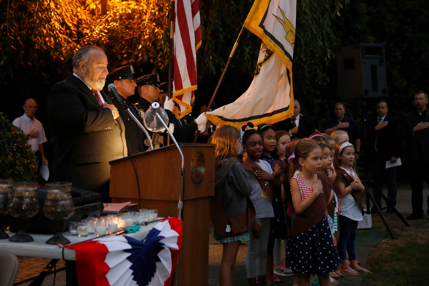 Brownies led the memorial crowd, including Mayor Francis X Murray, far left, in the Pledge of Allegiance.