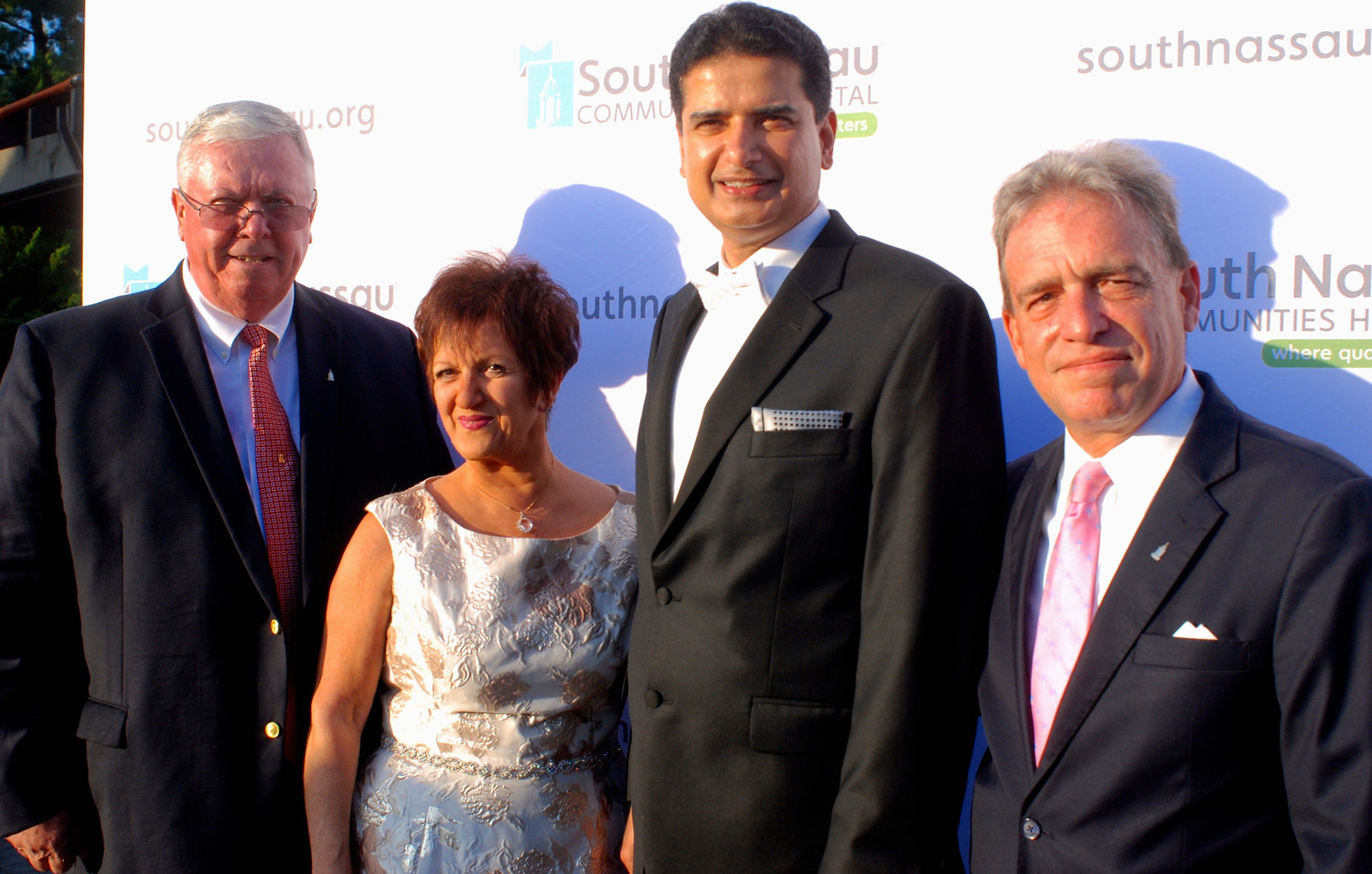 Richard Murphy, left, the South Nassau Communities Hospital president and chief executive officer; nurse Lori Edelman, recipient of the Cupola Award and director of patient care services, emergency departments and medical-surgical units; Dr. Rajiv Datta, recipient of the Mary Pearson Award and chairman of the Department of Surgery and director of the Gertrude and Louis Feil Cancer Center; and Joe Calderone, senior vice president for communications and development. Jeffrey Feil, not pictured, chief executive officer of the Feil Organization, was the evening's honoree.
