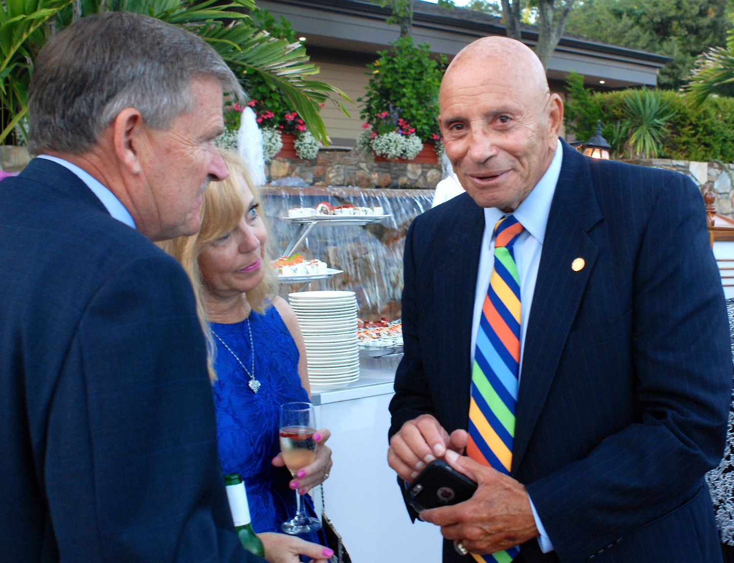 William Ulrich, left, vice president for administration, and his wife, Ethel, chatted with former New York State Assemblyman Harvey Weisenberg, of Long Beach.