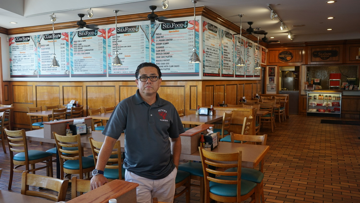 "Peter's Clam Bar manager Pepe Poblador in the restaurant at noon on a recent Friday. ""We usually get a decent crowd for lunch,"" he said."