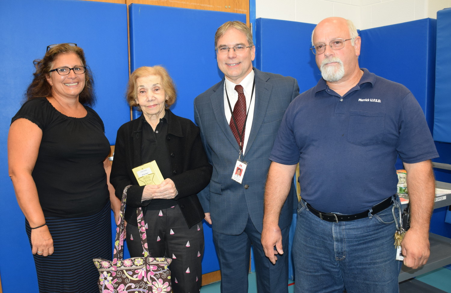 From left: Nancy Russo, Grayce Godfrey, Dr. Dominick Palma, and Kent Erikson. Erikson, Godfrey, Russo and Janet Iseman (not pictured) received special honors for their many years of service to the Merrick schools.