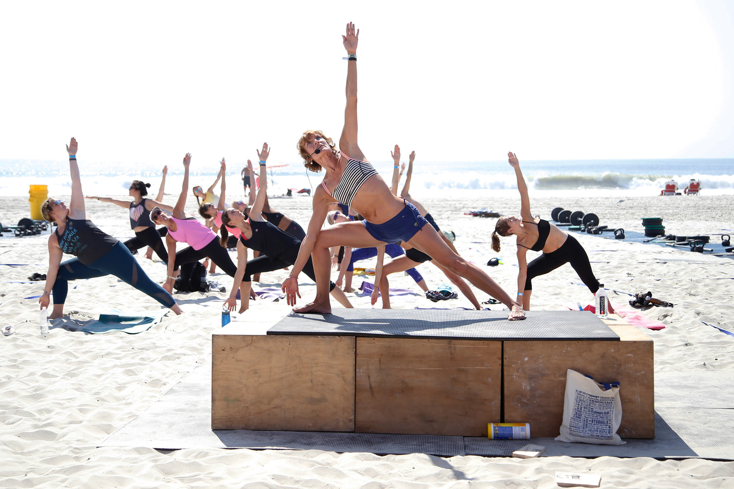Bikram Yoga instructor Anne Hayes guided a class at the fitness festival on Sunday.