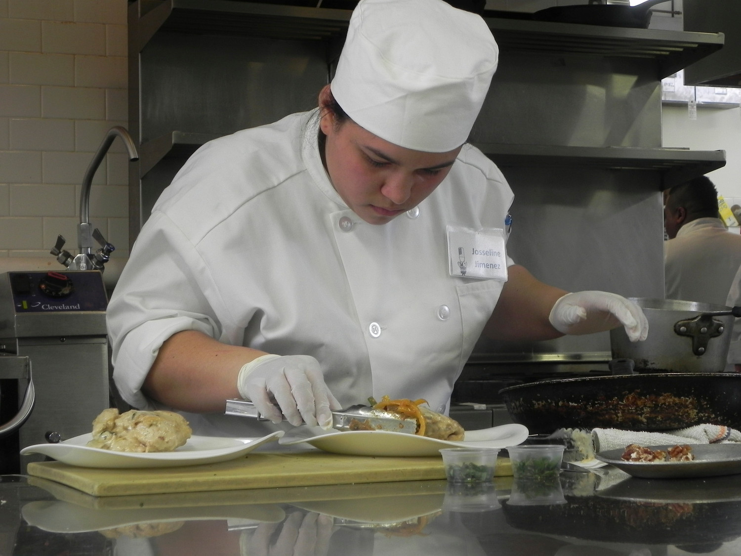 Three years ago, as a Lawrence High School senior, Josseline Jimenez competed for a culinary scholarship, above. Now she is a graduate of Monroe College who excelled academically majoring in hospitality management.