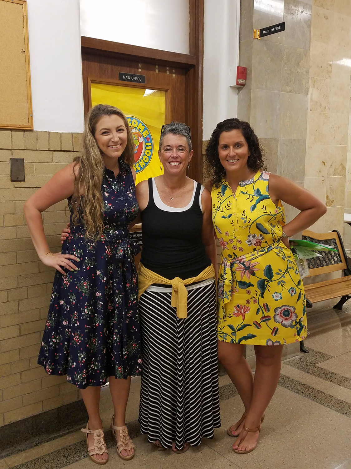 Polk Street School teachers Jenine Giacopelli, Marybeth Magan and Victoria Vitulli greeted their students for another year of instruction.