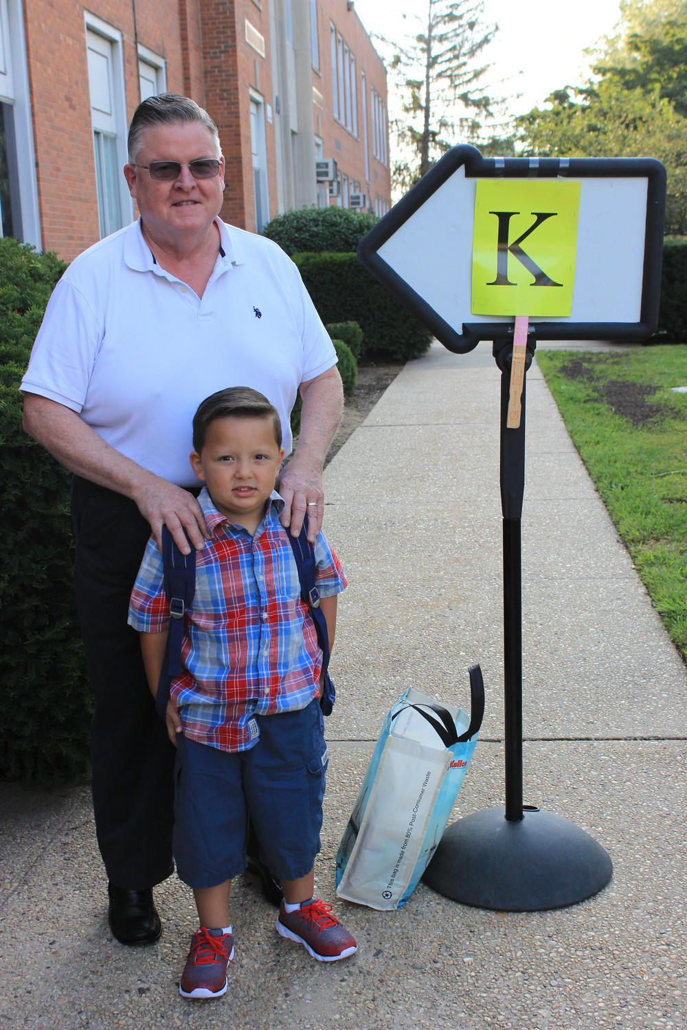 Mason Otero waited with his grandfather, Bill Gannon, to enter his kindergarten classroom and meet his new teacher.