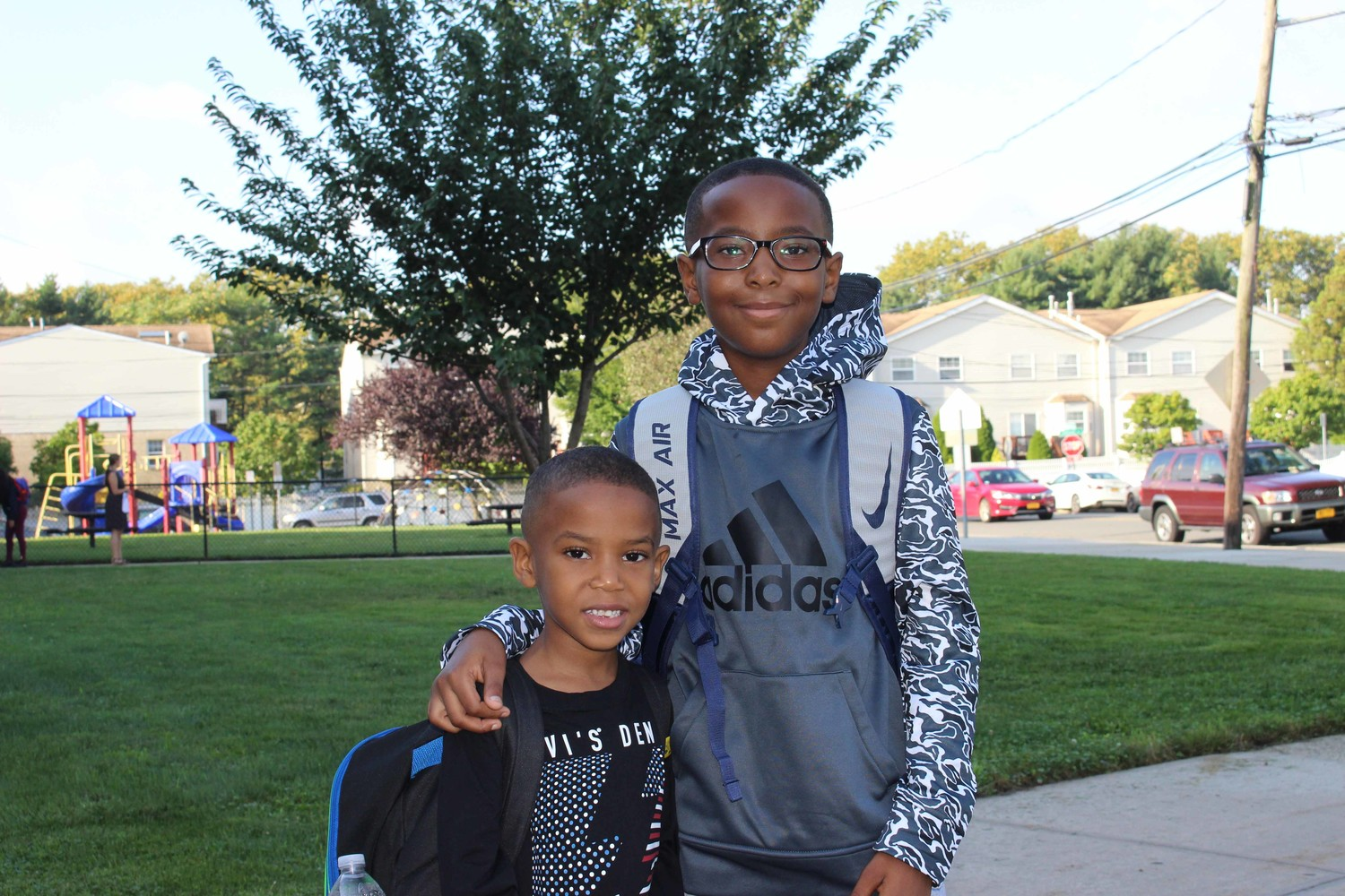 Clara H. Carlson kindergartner Tyler Edon and his brother Jaden Edon posed for photos to mark the first day of school.