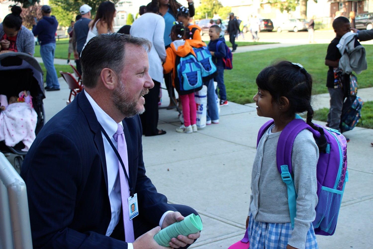 Clara H. Carlson's Assistant Principal Richard Mansfield was on hand to greet students, such as pre-K student Olivia Samaroo.