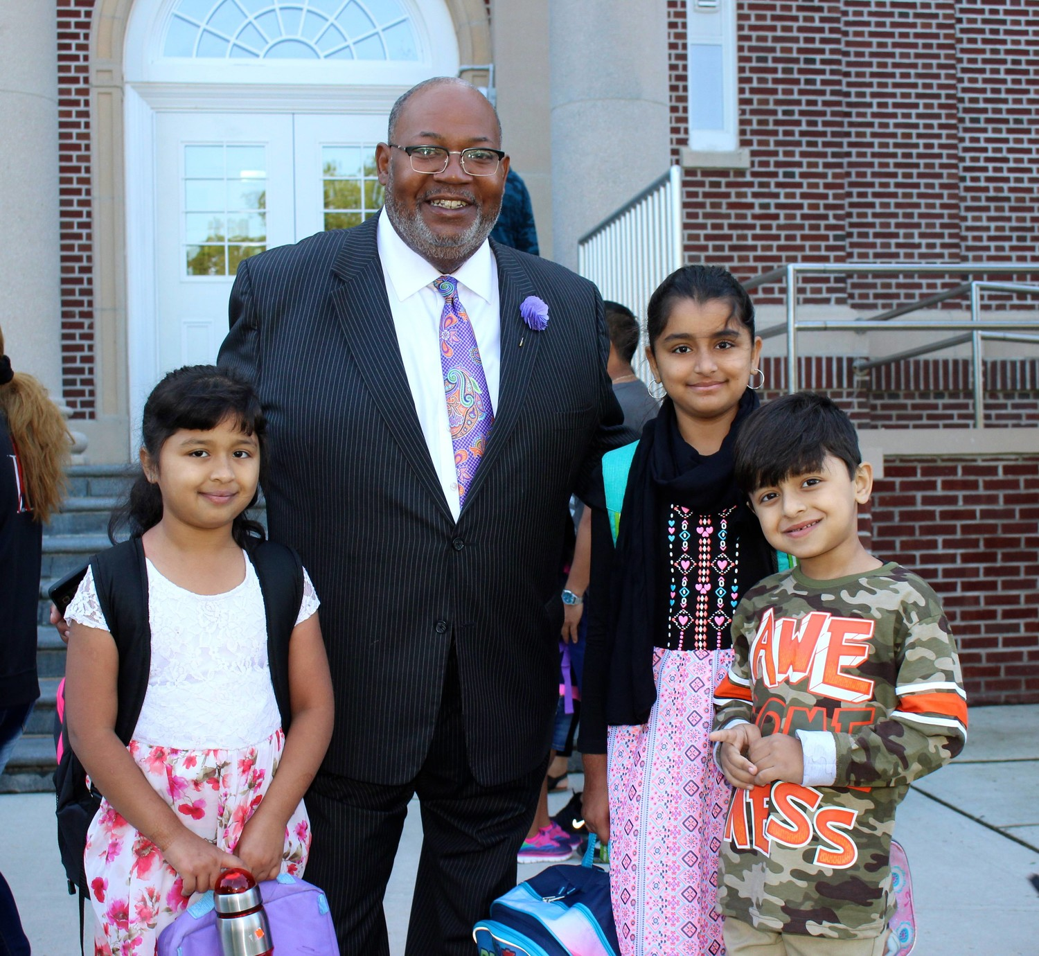 Superintendent of Schools Al Harper greeted students as they entered Clara H. Carlson for the first day of school, such as siblings Sara Shahdat, Fiza Shahdat and Tabish Bhatti.