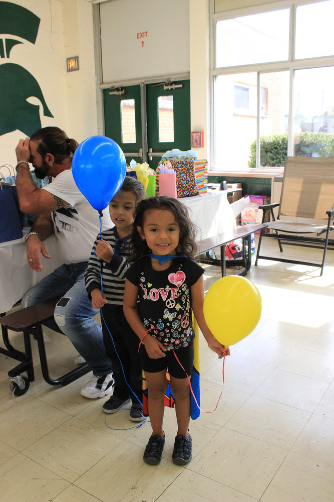 Twins Santino and Solana Boccasini, 5, of Gotham Avenue Elementary School, enjoyed the festivities and got balloons to take home.