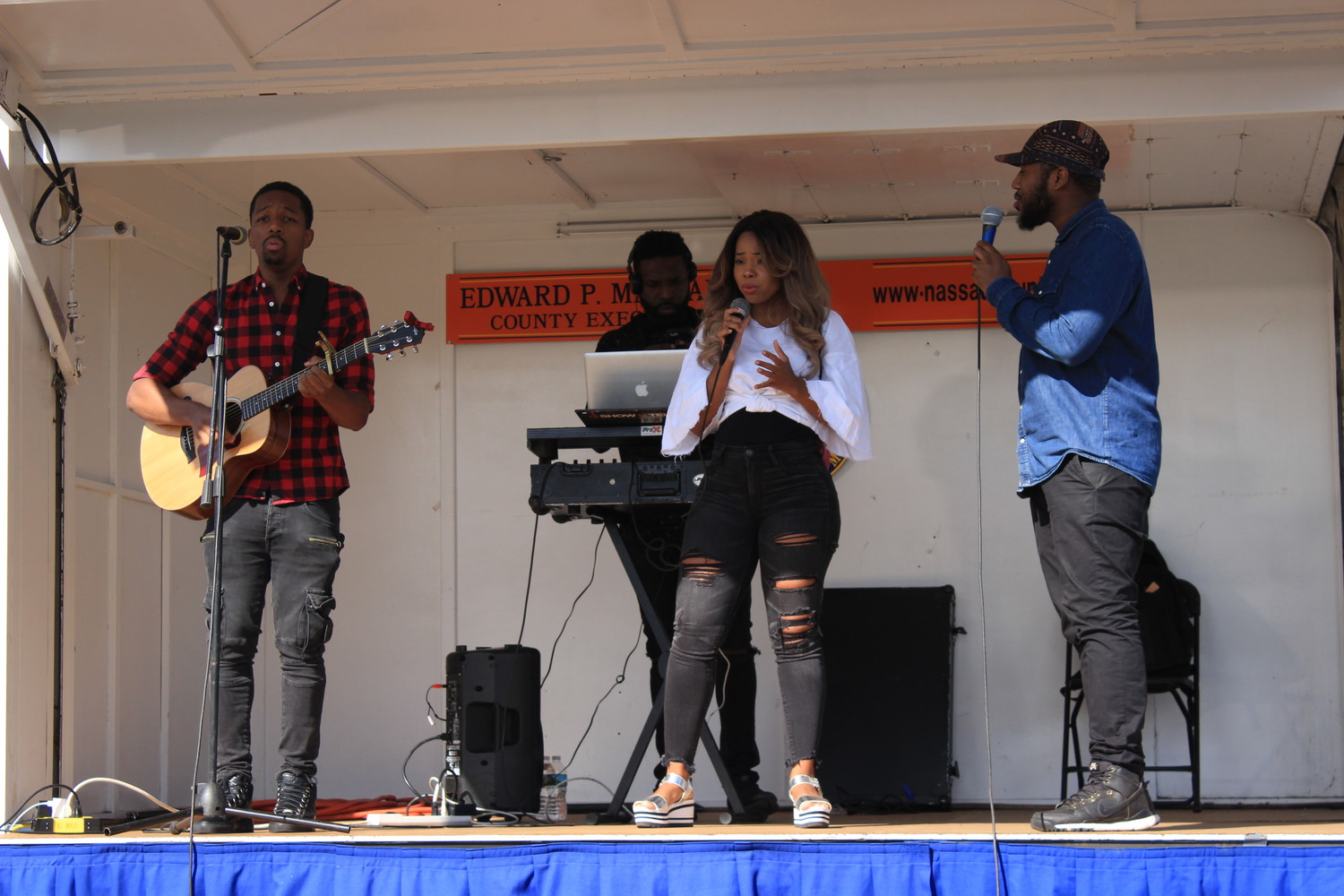 Elmont's own Written Melody performed at the Elmont Family Fun Day on Sept. 9. In front, from left are Kenyatta Blakeley, Katrina Black and Will Ferdinand. In the back is D.J. Showntell.
