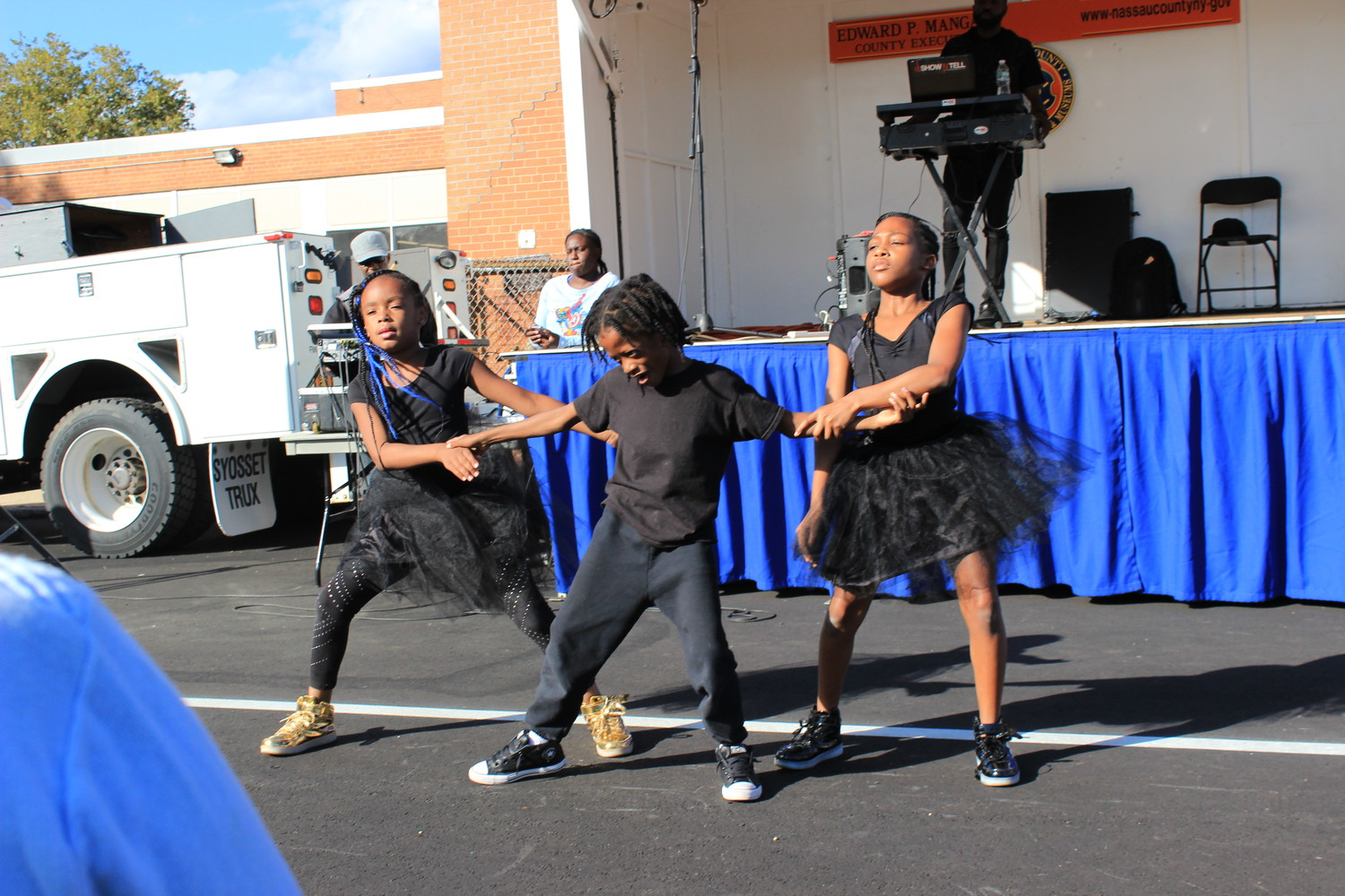 At the Elmont Family Fun Day, performers from Layla's Dance and Drum in North Valley Stream did a dance routine to entertain the crowd.