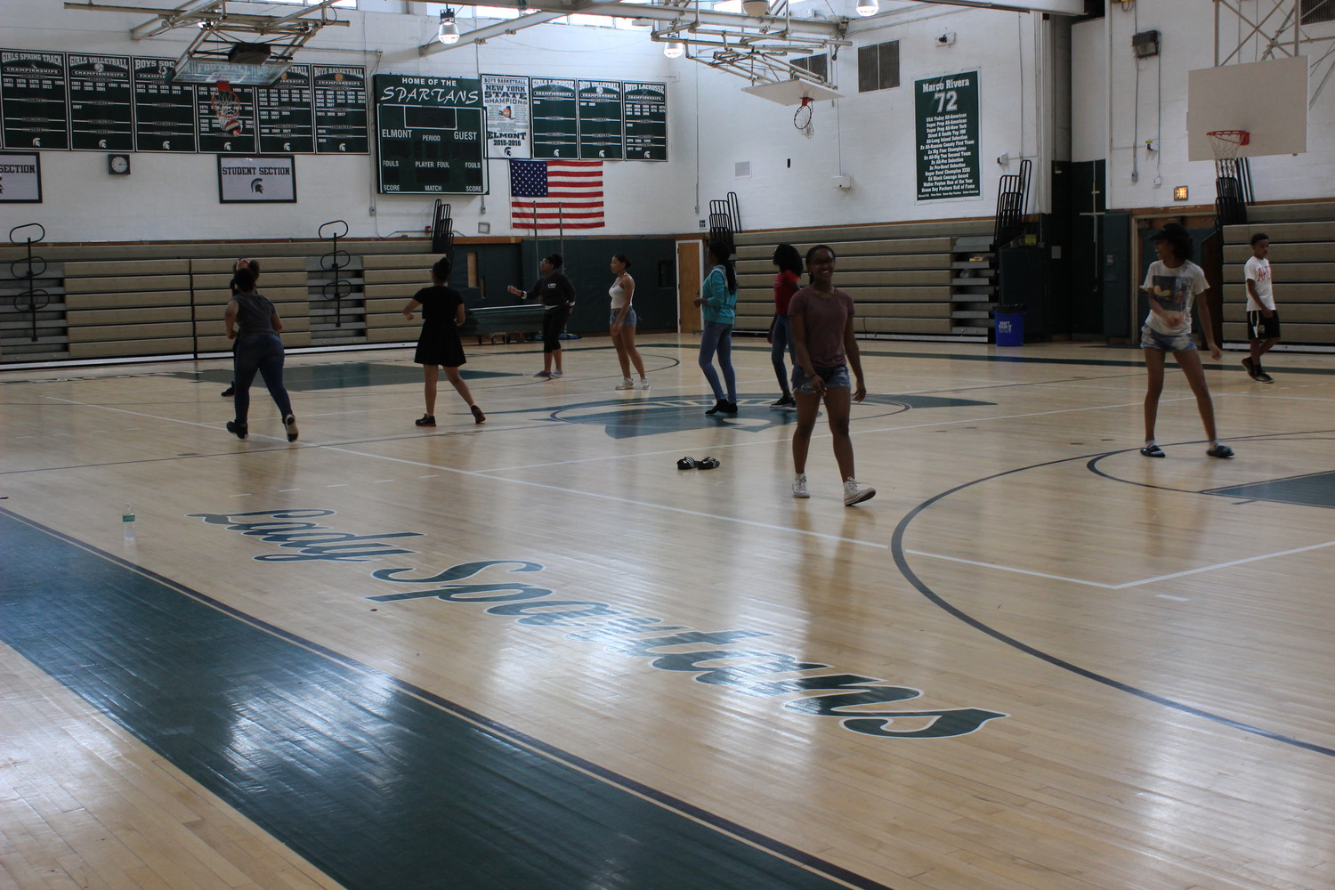 One of the major updates that has taken place over the years has been its gymnasium. The new gym has more space, flooring and changes to its entrance. Children played volleyball on the new floor.