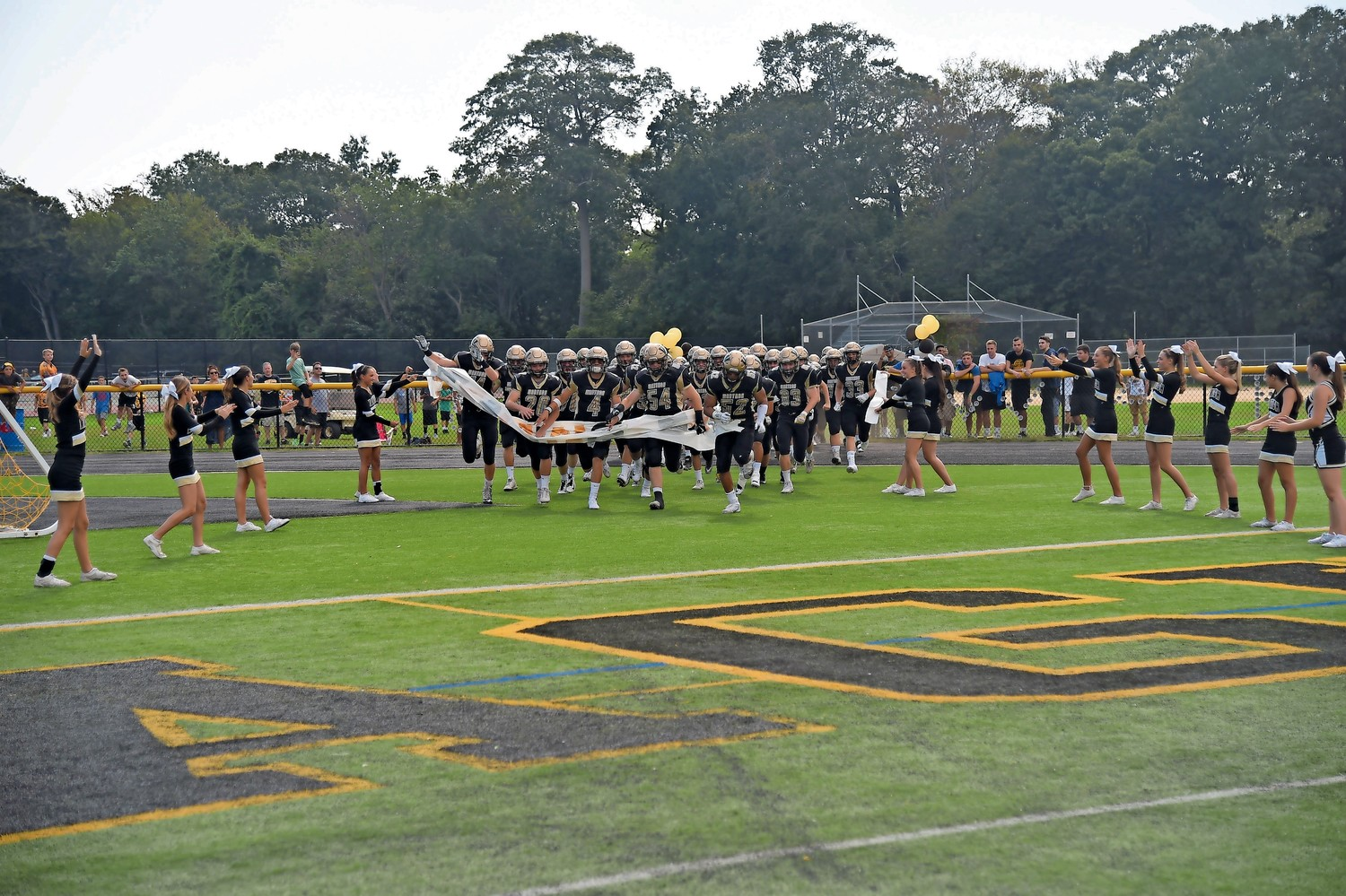 The Wantagh High School football team charged onto the field before the Homecoming game on Sept. 16.