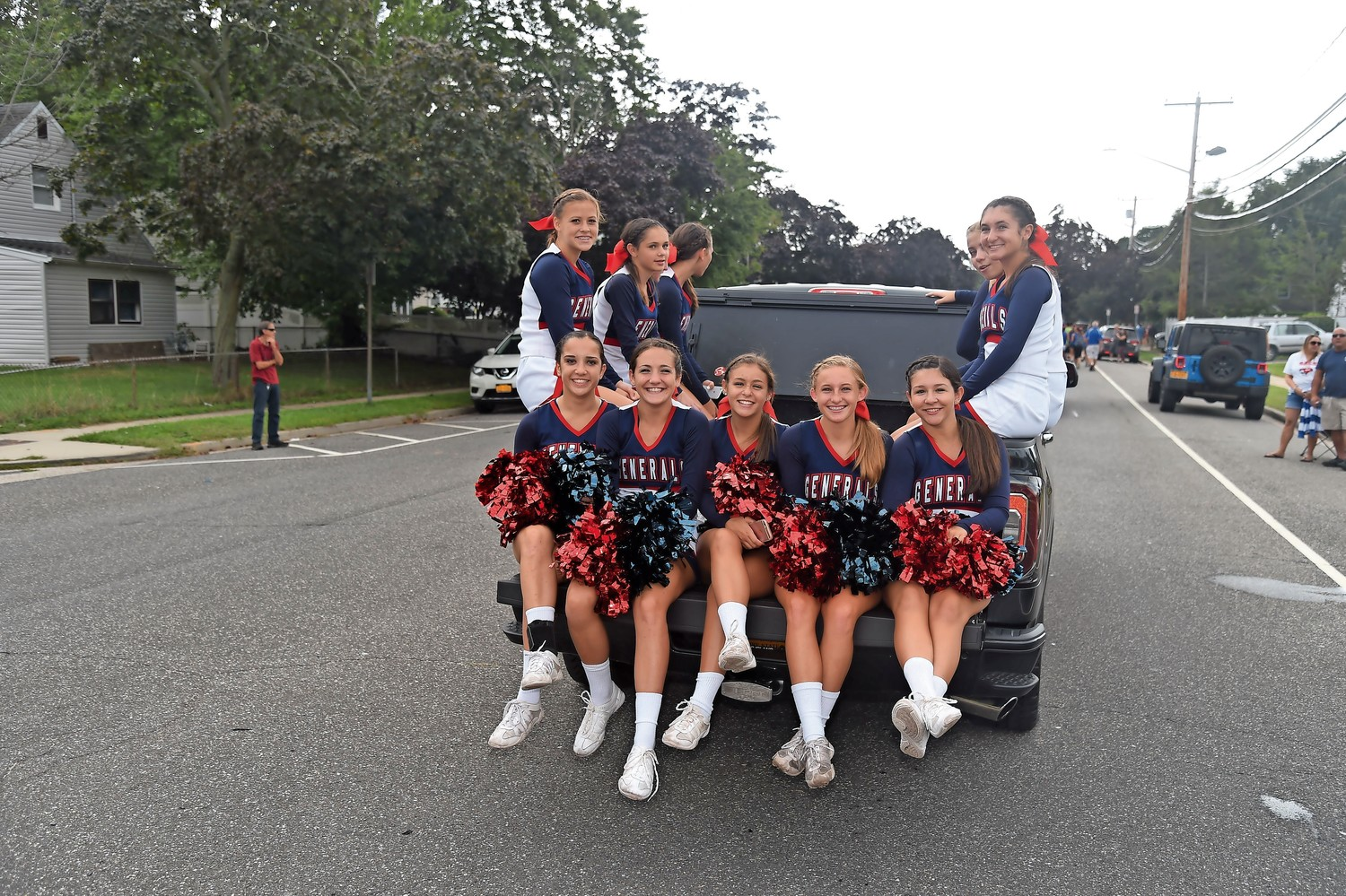 The varsity cheerleaders chanted along the parade route.