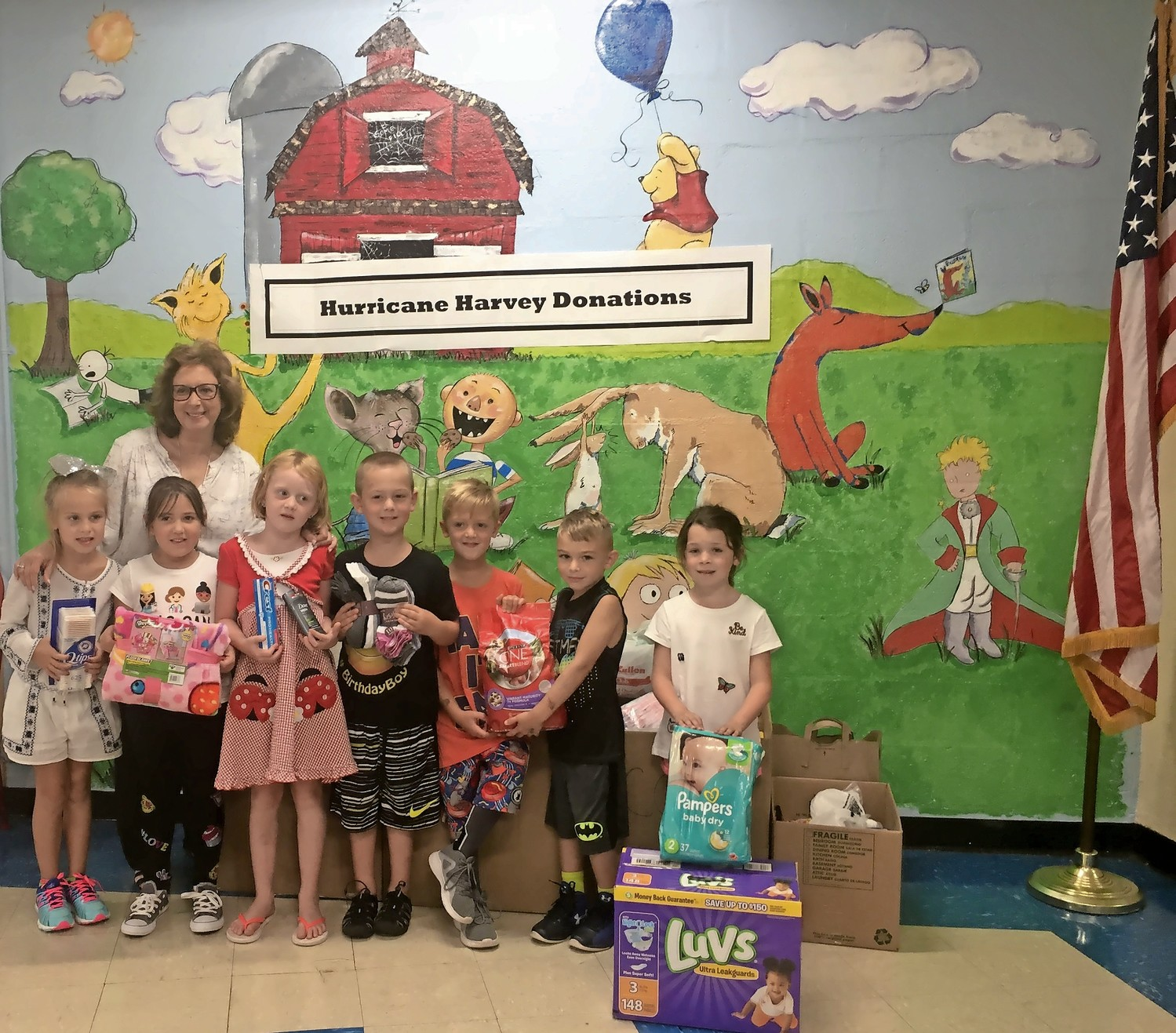 Cheryl Schwartz, back left, a first-grade teacher, conceptualized Mandalay Elementary School's Hurricane Harvey relief drive. Her students donated supplies, which were sent to storm victims.