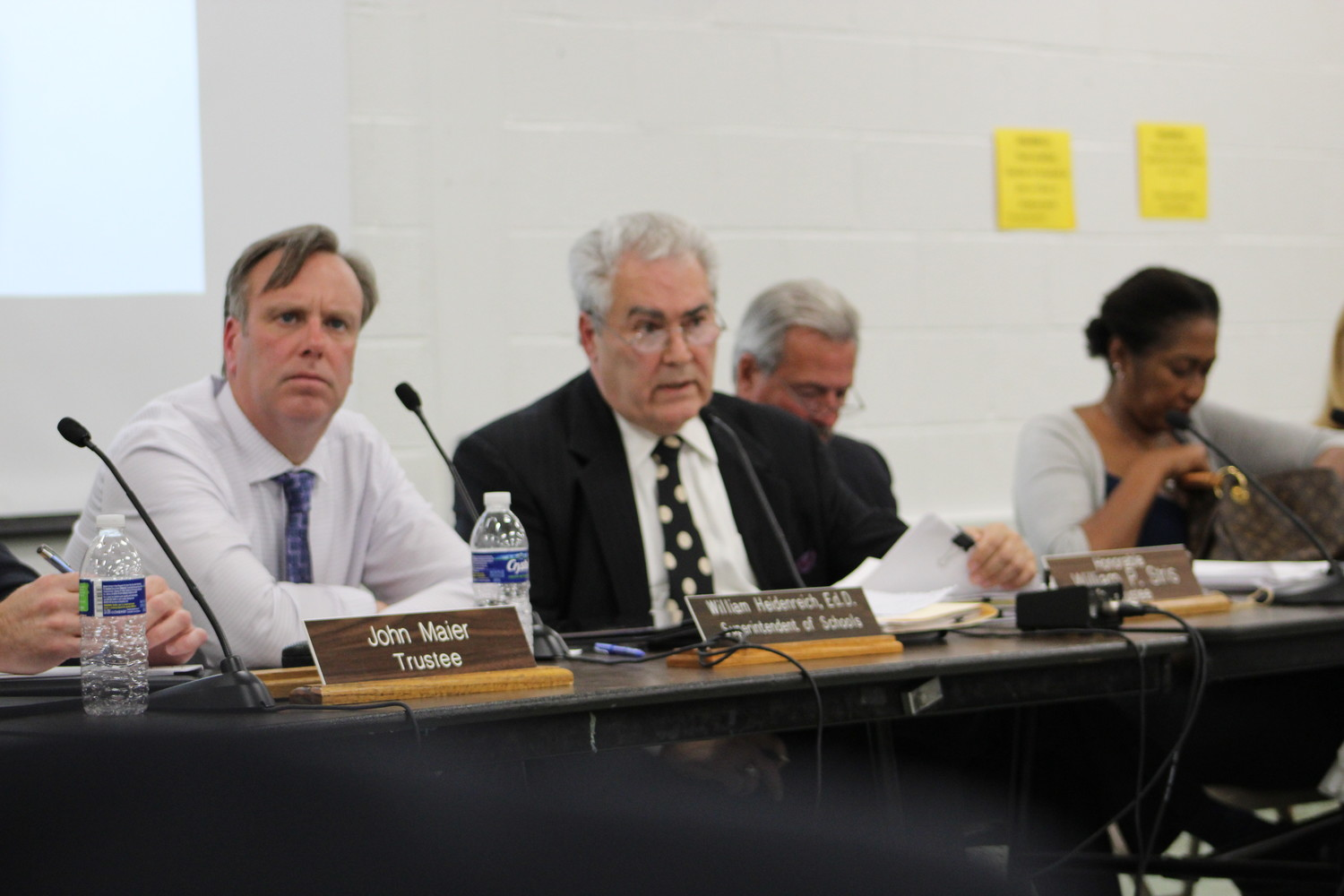 Superintendent Bill Heidenreich, left, and school board President William Stris listened as residents discussed the waiver policy issue at an Aug. 29 board meeting.