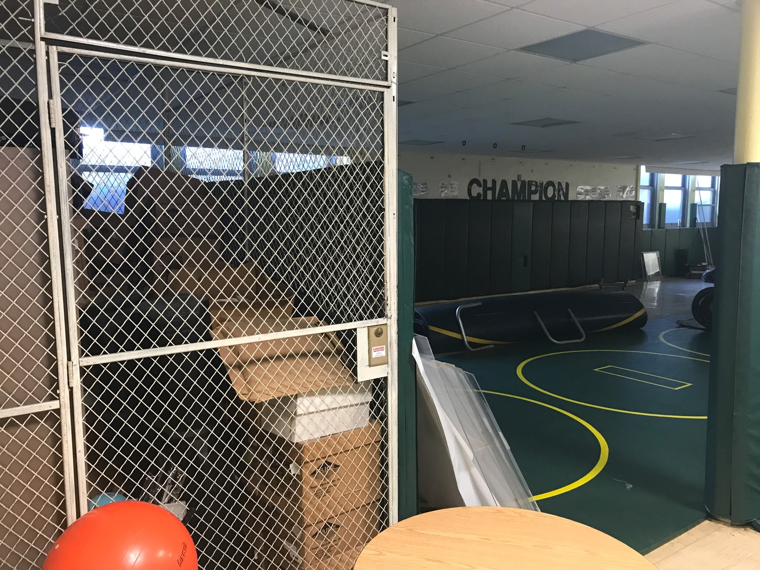 The dingy wrestling room at the Lynbrook Kindergarten Center — where the high school team practices — also doubles as storage space for district records.