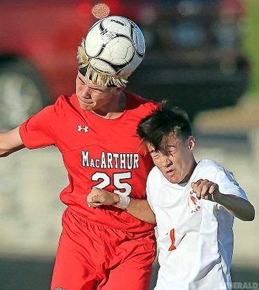 MacArthur's Brandon Buchan, left, was a head above Carey's Vincent Moreno during the Generals' 3-2 conference victory on Sept. 8.