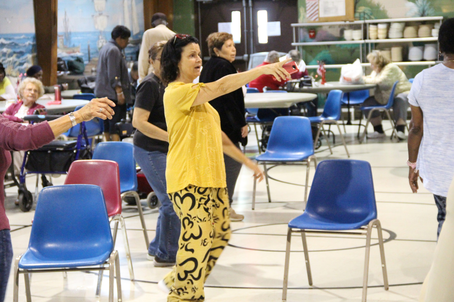Certified Yoga Instructor Anne Moffatt, 56, showed the exercise class how to do the dance steps at the senior center off Church Street in Freeport.