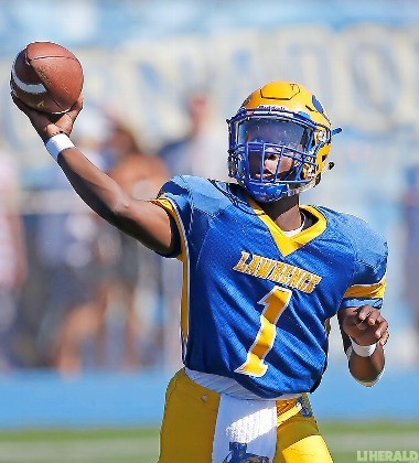 Lawrence junior quarterback Christian Fredericks has a touchdown-to-interception ratio of 9-to-0 through the first four games, including three victories.