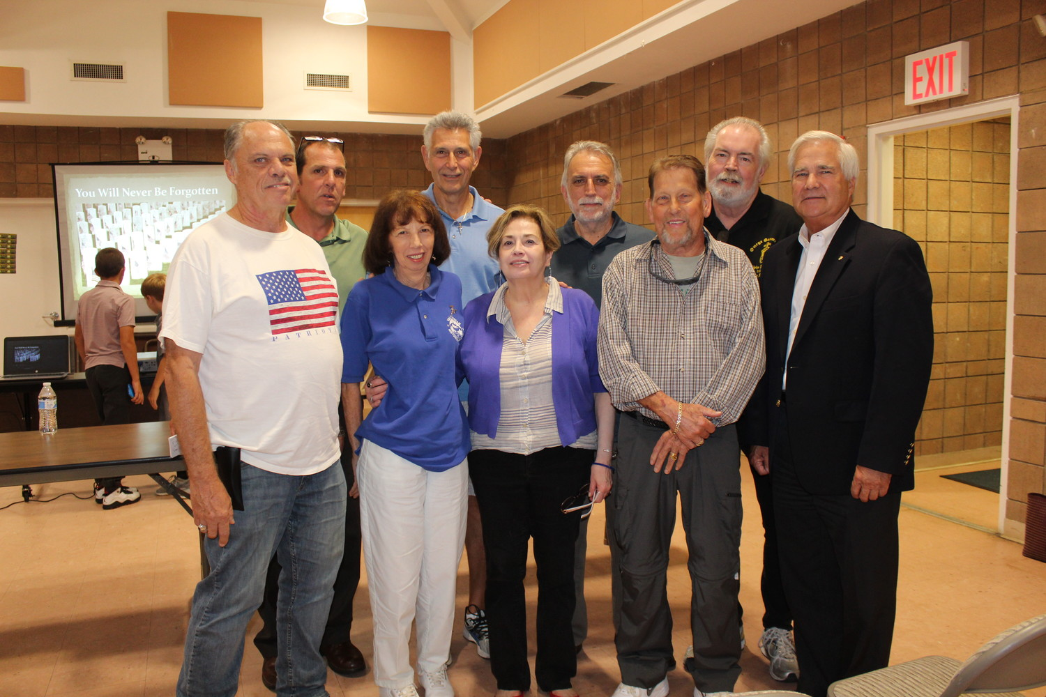 Central High School alumni and local veterans attended the Sept. 27 meeting of the Valley Stream Historical Society to learn about Chris Critchley's research. Critchley was second from left.