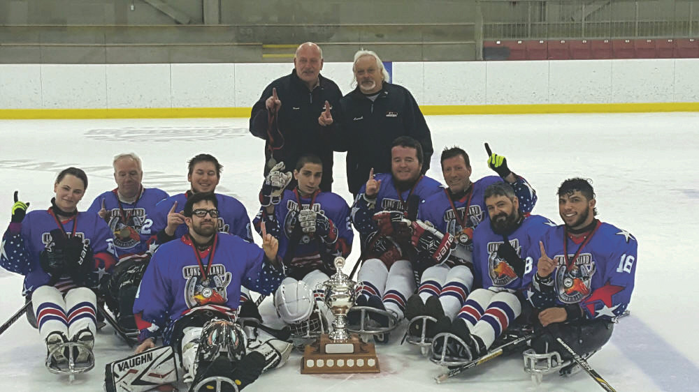 "The Long Island RoughRiders sled hockey team for differently abled athletes was recently featured on ""Returning the Favor,"" a Facebook show hosted by Mike Rowe. Last April, the team won the O'Keefe Cup in Ottawa by going 6-0. Above, from left, players Sara Tabor, Anthony Fitzgerald, Adam Mertz, Matty Castagna, Michael DiPientrantonio, Sean Laslo, Chris Bustamante, Larry Minei and Ray Diaz celebrate the victory with Frank Martin, back left, the manager and vice president of Long Island Sled Hockey, and head coach Phil Derenze."