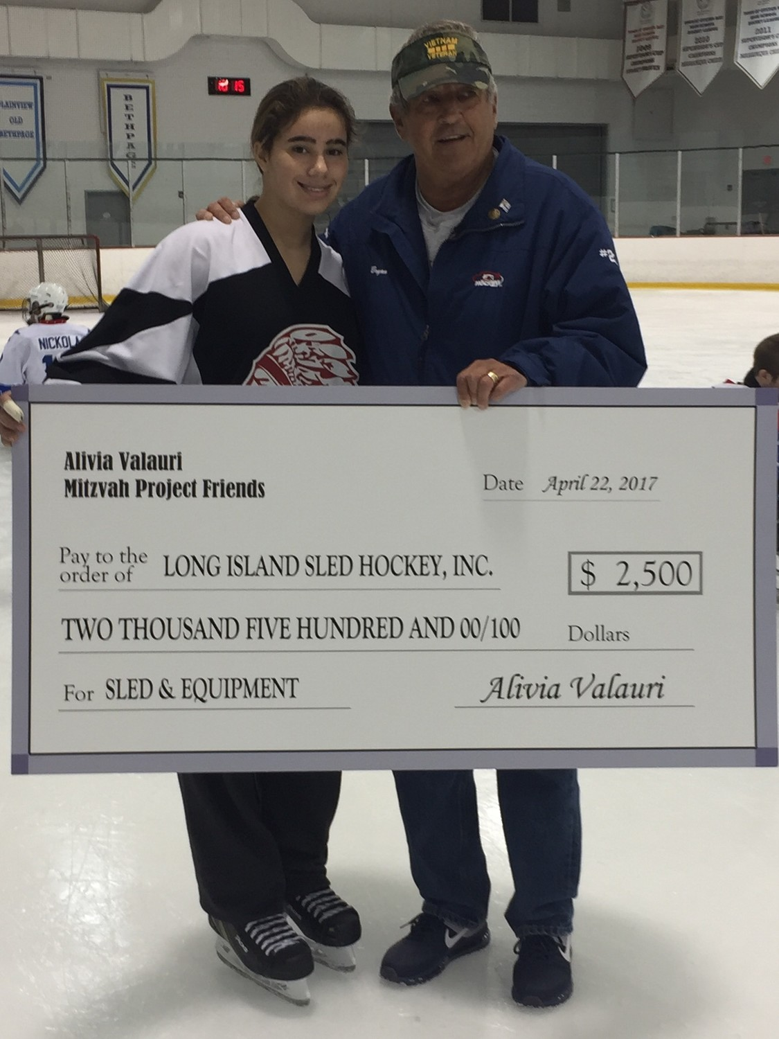 Bryan Blomquist, right, regularly raises money for Long Island Sled Hockey. Volunteer Alivia Valauri, 12, raised $2,500 on her own to help provide the team with sleds and equipment.