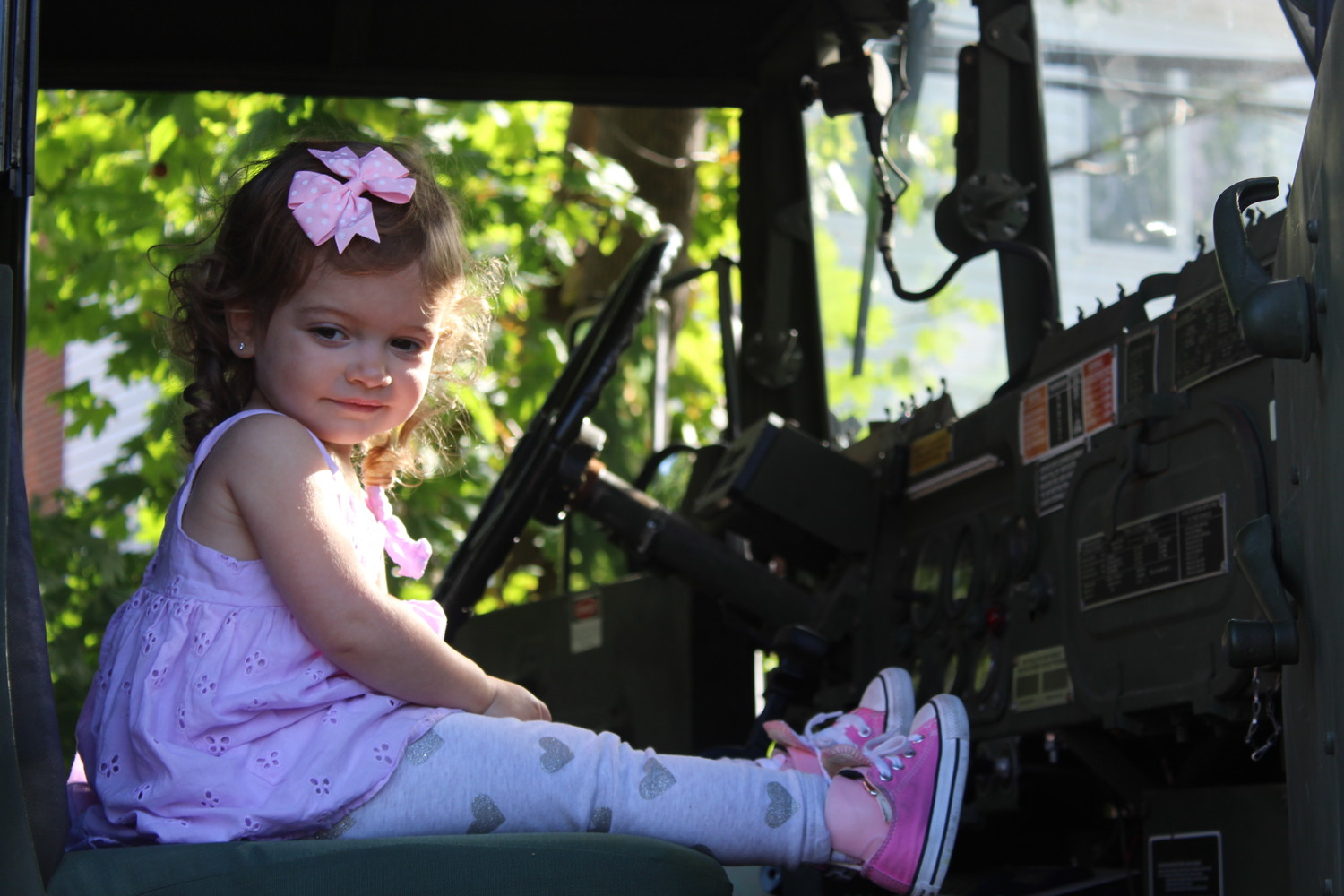 Emily Ruditser, 2, got an inside look at East Rockaway's Emergency Management truck during the Truck Day event at the Hewlett-East Rockaway Jewish Centre's nursery school.