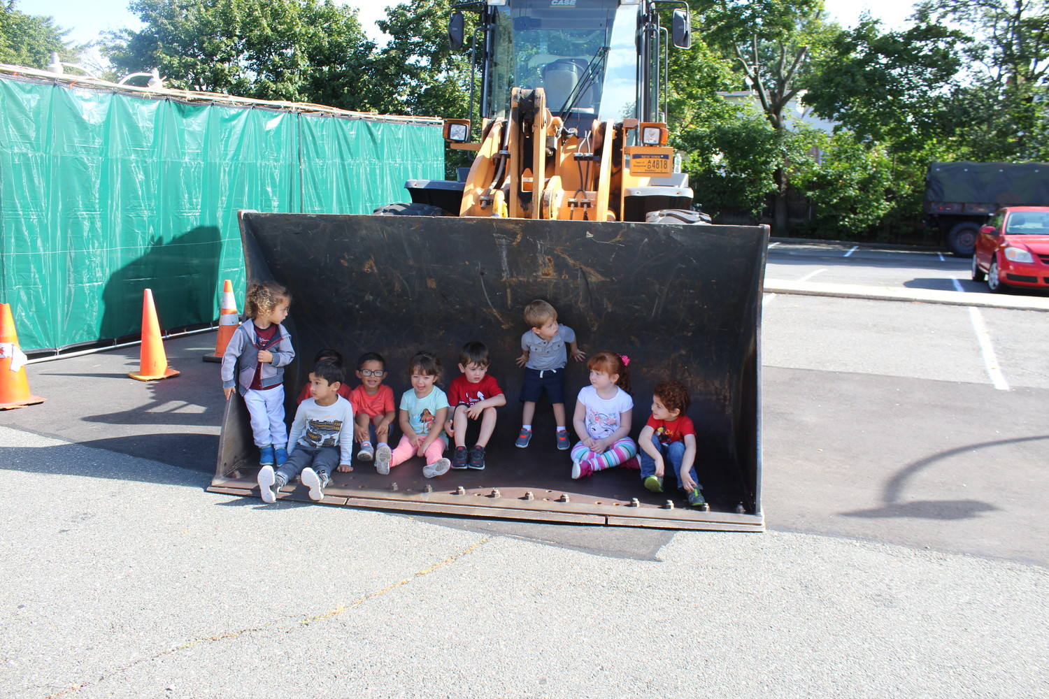 A class of 3-year-olds sat on the excavator of a backhoe truck during Truck Day at the Hewlett-East Rockaway Jewish Centre on Sept. 27.