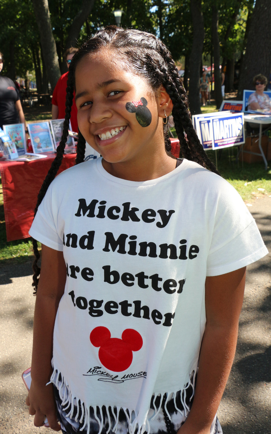 Jiyannah Perez, 9, got her face painted with Minnie Mouse.