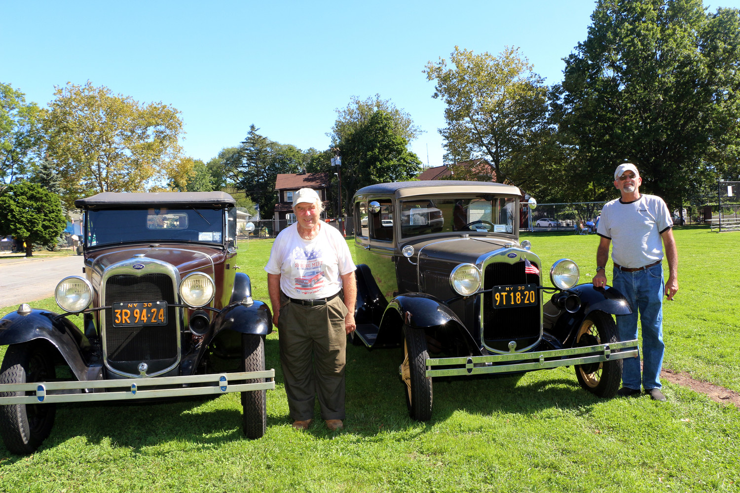 Harry Verity, left, and David Siegel showed off their Model A Fords, which were two of about 60 old cars being displayed at the Expo.