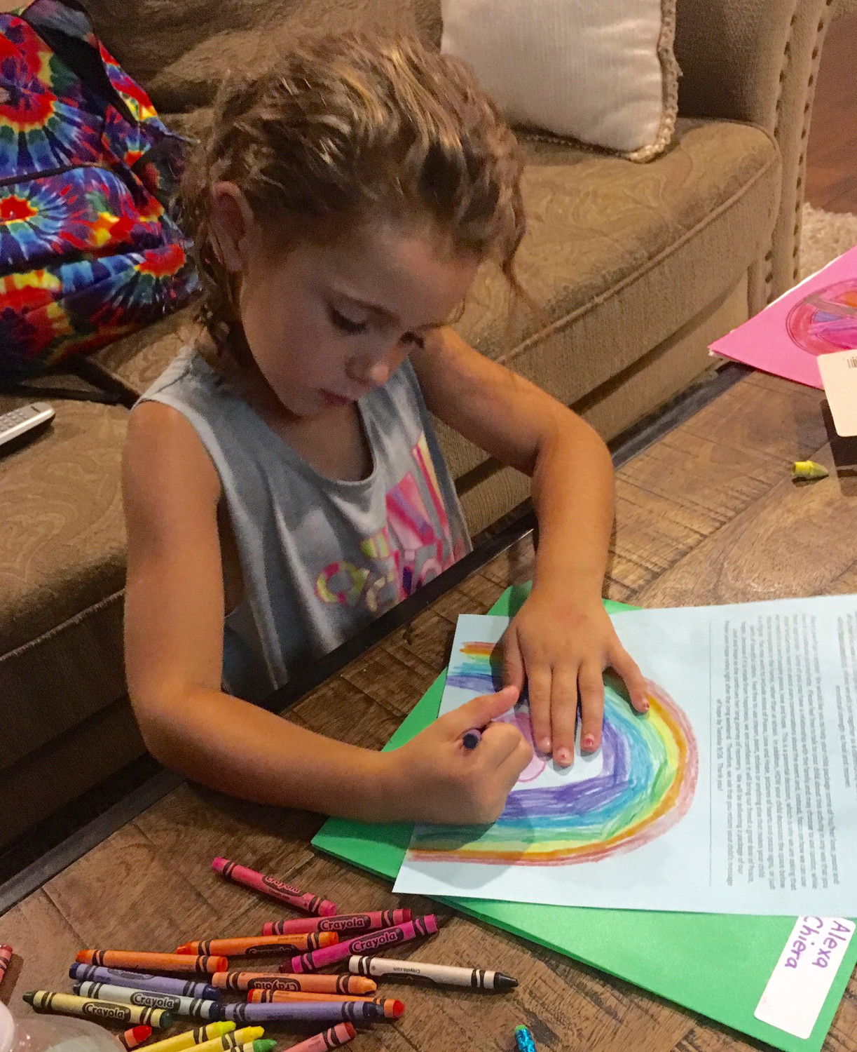 "Kindergartener Alexa Chiera working on her ""Peace - Love - Hope"" project for Lara."