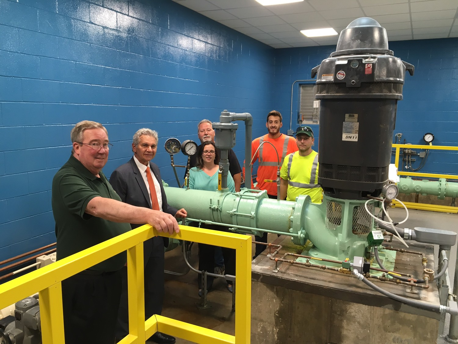 Mayor Reggie Spinello, second from left, received a tour of the new Duck Pond Road well's filtration system from Glen Cove DPW Director James Byrne, left, Denise O'Connor, Water Service Foreman Michael Colangelo, Daniel Ermmarino and Kevin Basile.