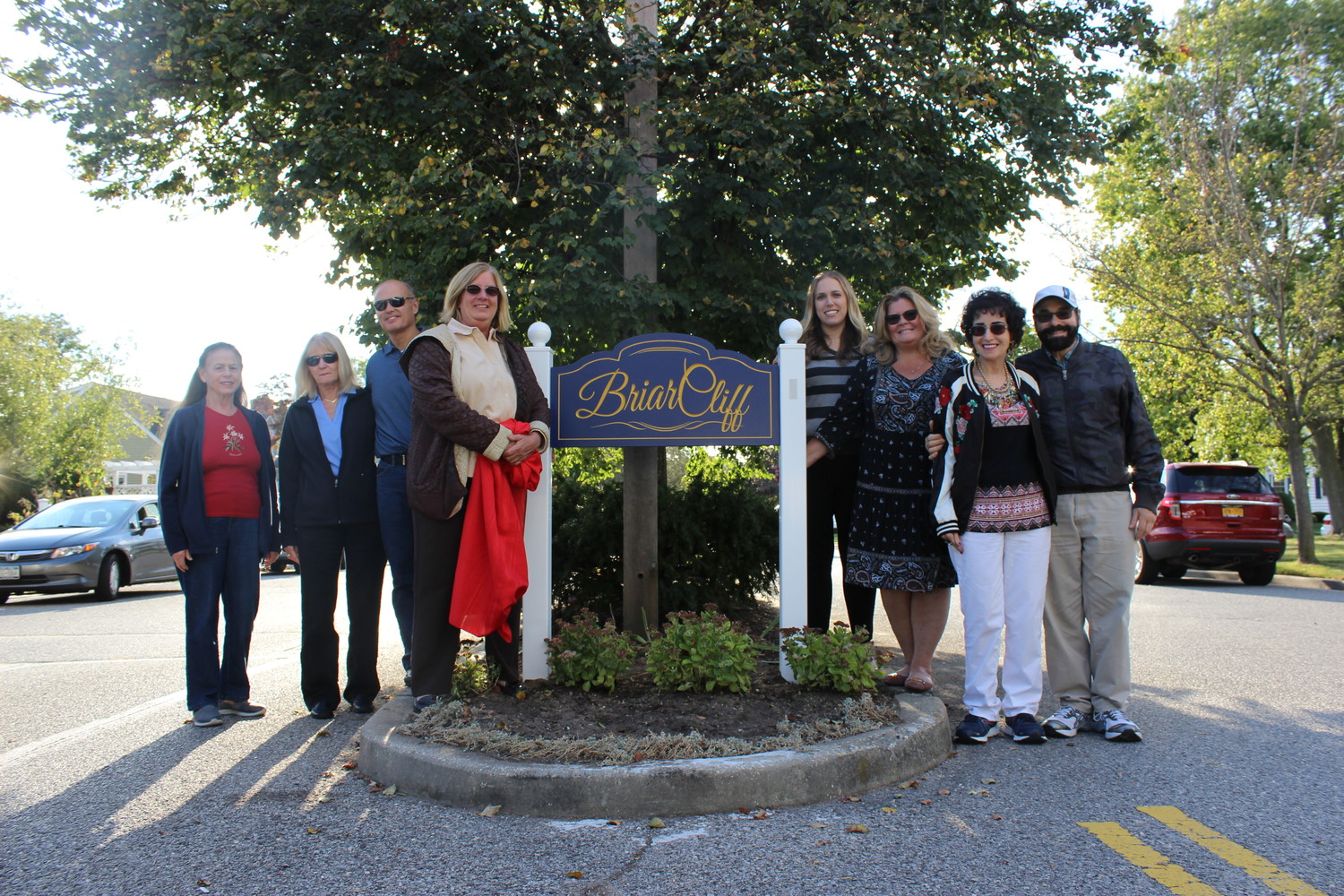 Community members gathered on Sept. 29 to unveil a new sign welcoming residents into the BriarCliff section of North Merrick.