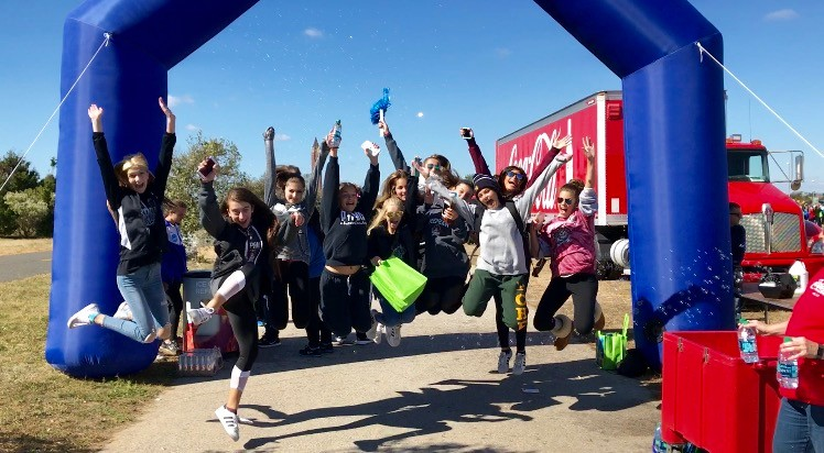Mepham junior varsity cheerleaders walked to support autism awareness and research at the 18th annual Autism Speaks Walk last weekend at Jones Beach