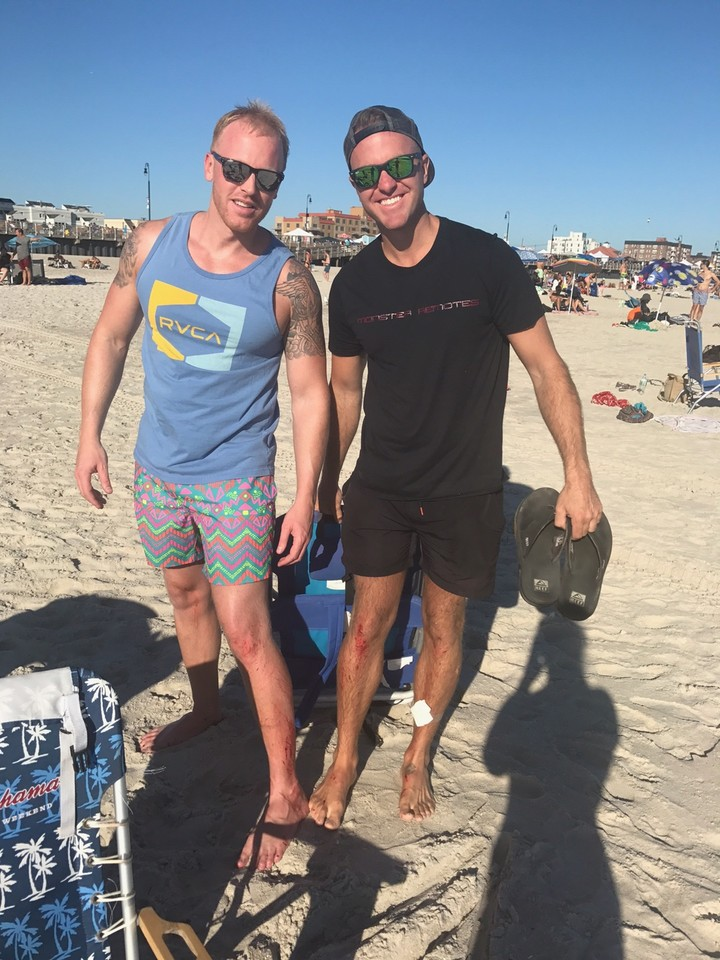 Rhame Avenue Principal Erik Walter, right, and his friend Gregory Dressel had scrapes on their legs and feet after they jumped into the water at Edwards Boulevard, in Long Beach, to rescue two girls who were drowning.