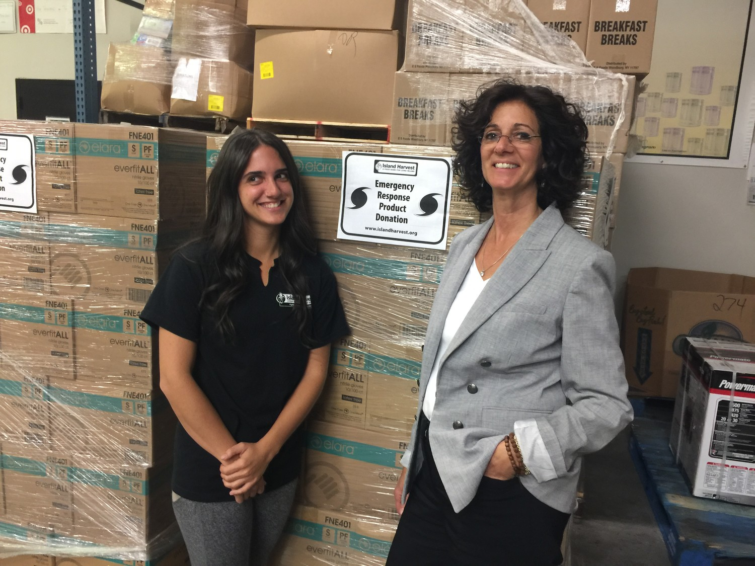 Rebecca Dresner, left, flew to Puerto Rico on Monday to help distribute food collected by the Island Harvest Food Bank. Her mother, Randi Shubin Dresner, president and CEO of the hunger-relief organization, said that Island Harvest had collected more than half a million pounds of nonperishable food, bottled water and cleaning supplies since early September to aid hurricane-stricken areas.