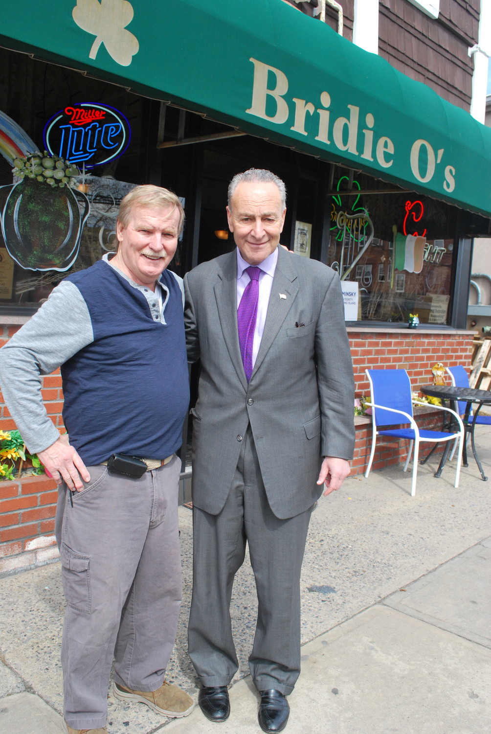 Bridie O's co-owner Jimmy Dowling, left, with Sen. Charles Schumer outside the Lawrence bar on Central Avenue in 2016.