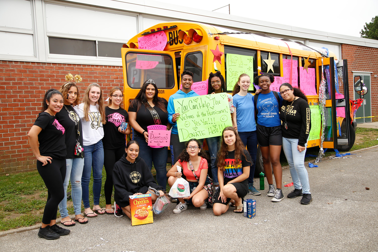 The West Hempstead High School Key Club collected food and donations for hurricane victims during the homecoming parade.