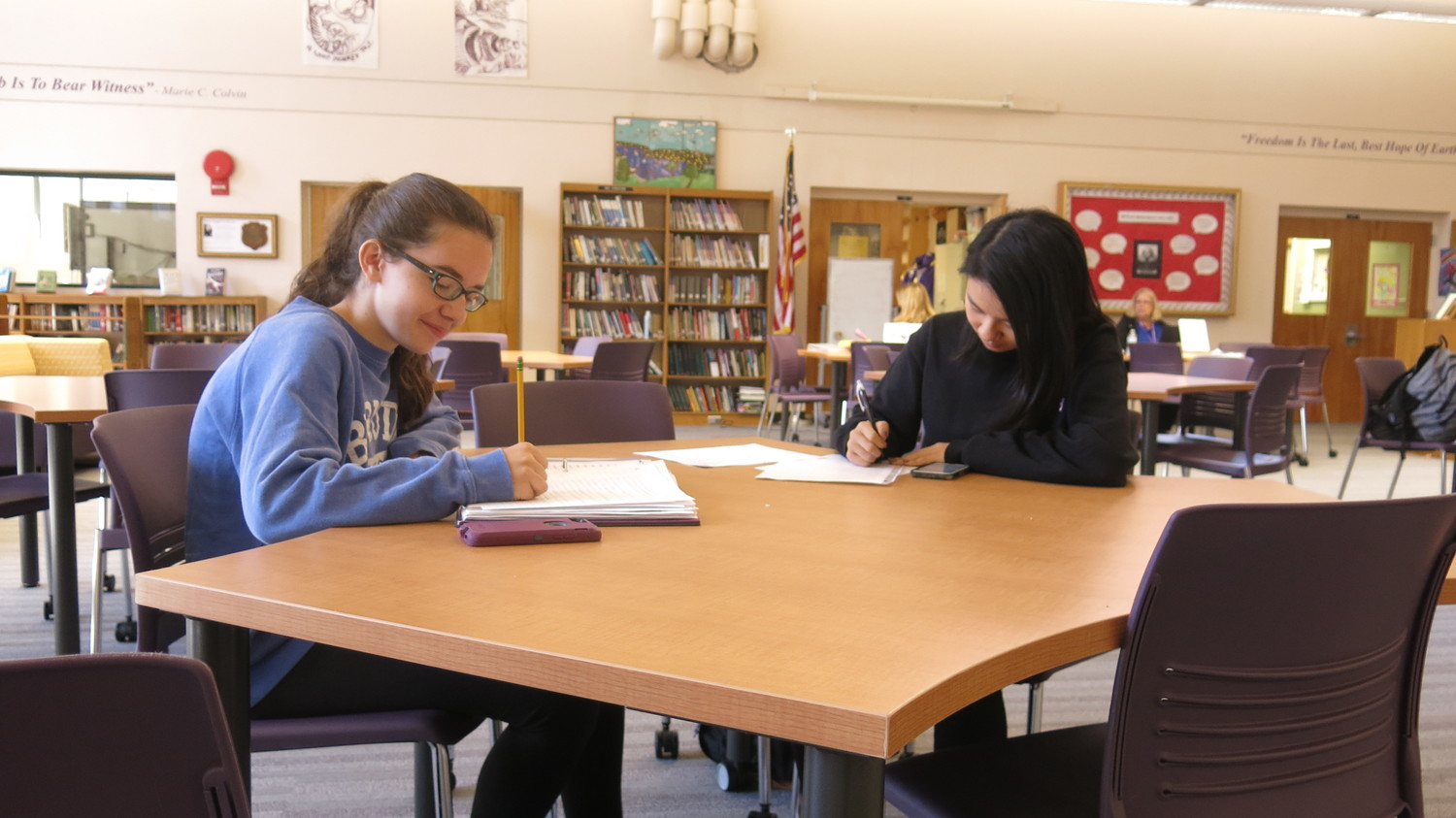 Lindsey Purcell, left, and Joycelin Wong said they liked the new tables in the Oyster Bay High School library because they are more conducive to group work.