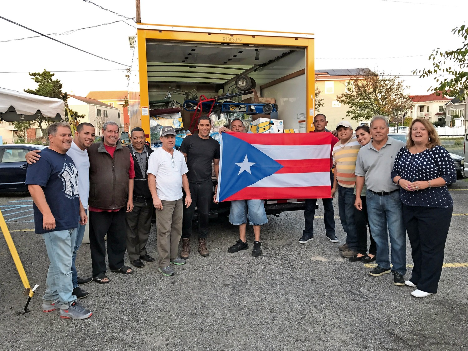 Members of the Long Beach Latino Civic Association loaded a truck on Tuesday with supplies that will be shipped to Puerto Rico as part of a local relief effort.