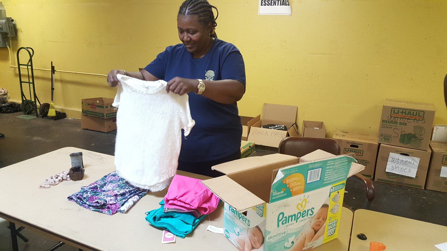 Volunteer Tracey Matthews sorted and folded clothing donations to be sent to Hurricane Harvey, Irma and Maria victims in Texas and the Caribbean.