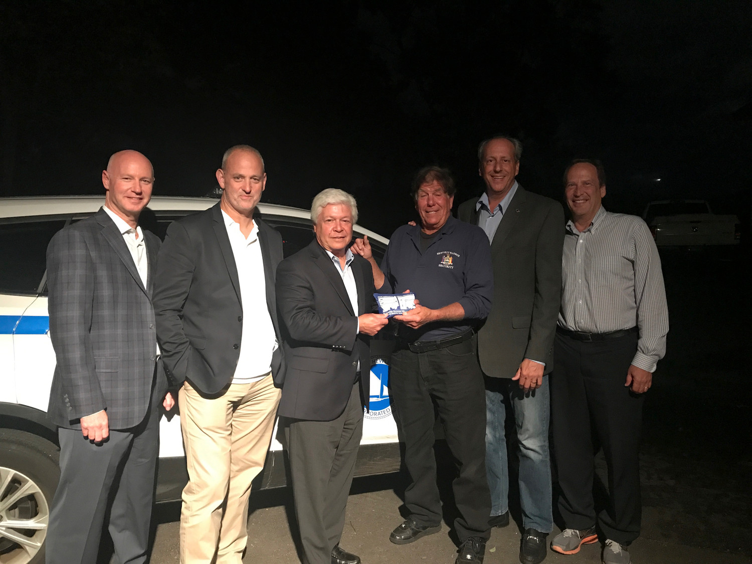 Hewlett Harbor village outfitted their security patrol with Narcan units. From left were Jonathan Polakoff, trustee/fire commissioner; Leonard Oppenheimer, deputy mayor; Mark Weiss, mayor; Gene Condrill, security; Thomas Cohen, trustee/police commissioner; and Kenneth Kornblau, trustee/deputy police commissioner.