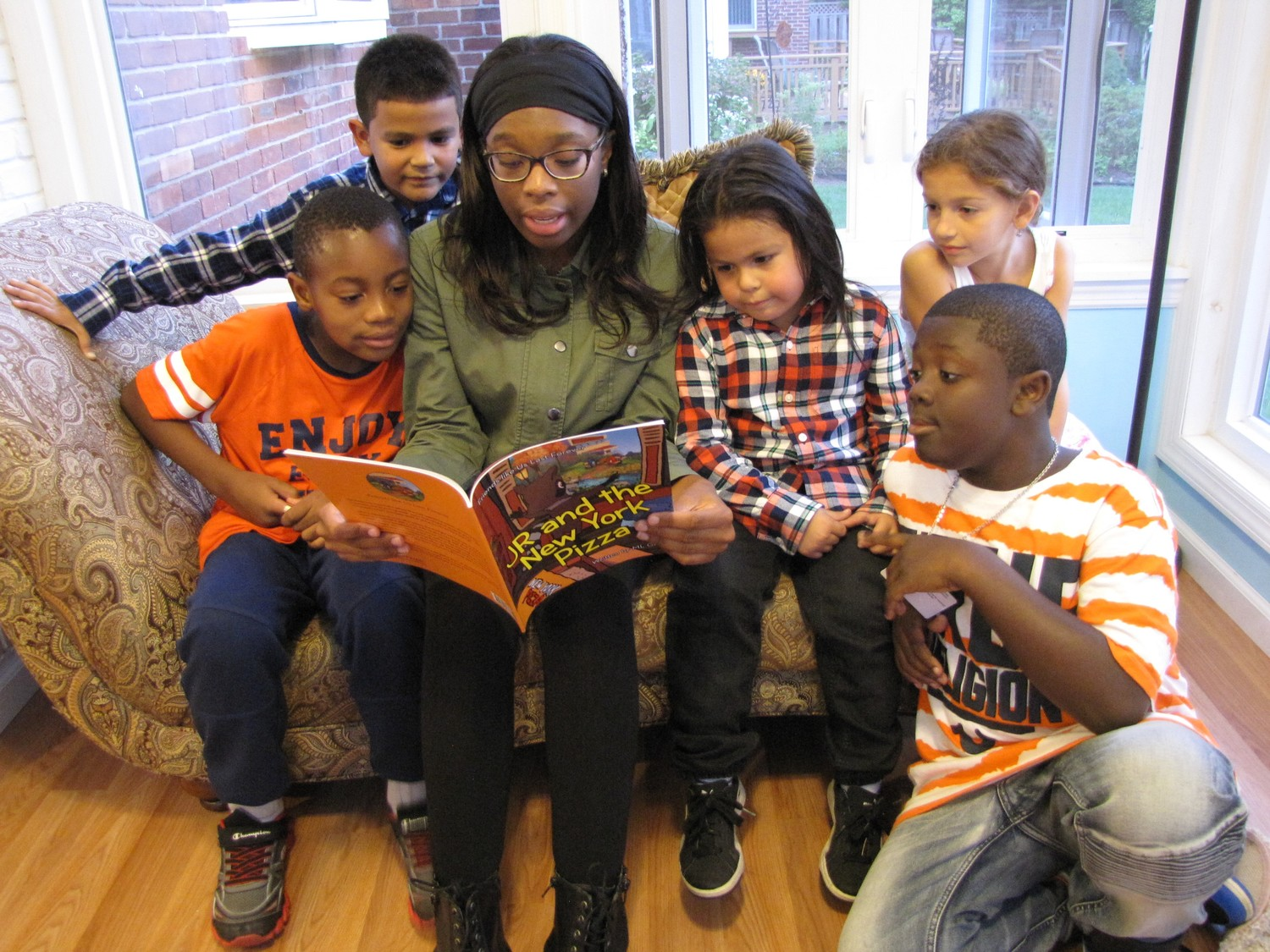 "Sixteen-year-old Kayla Ham took time, after school on Tuesday, to read ""JR and the New York Pizza to elementary school students."