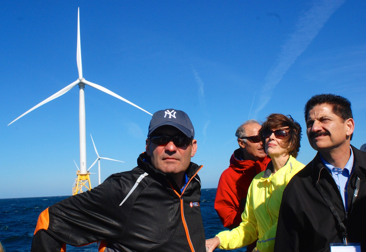 The Long Island Association, in conjunction with Stony Brook University's Advanced Energy Research Center, the Gershow Recycling Corporation and Deepwater Wind, hosted a tour last Wednesday of the wind farm recently constructed three miles off the Block Island coastline. At center, in yellow, was LIA Board of Directors member Katherine Heaviside.