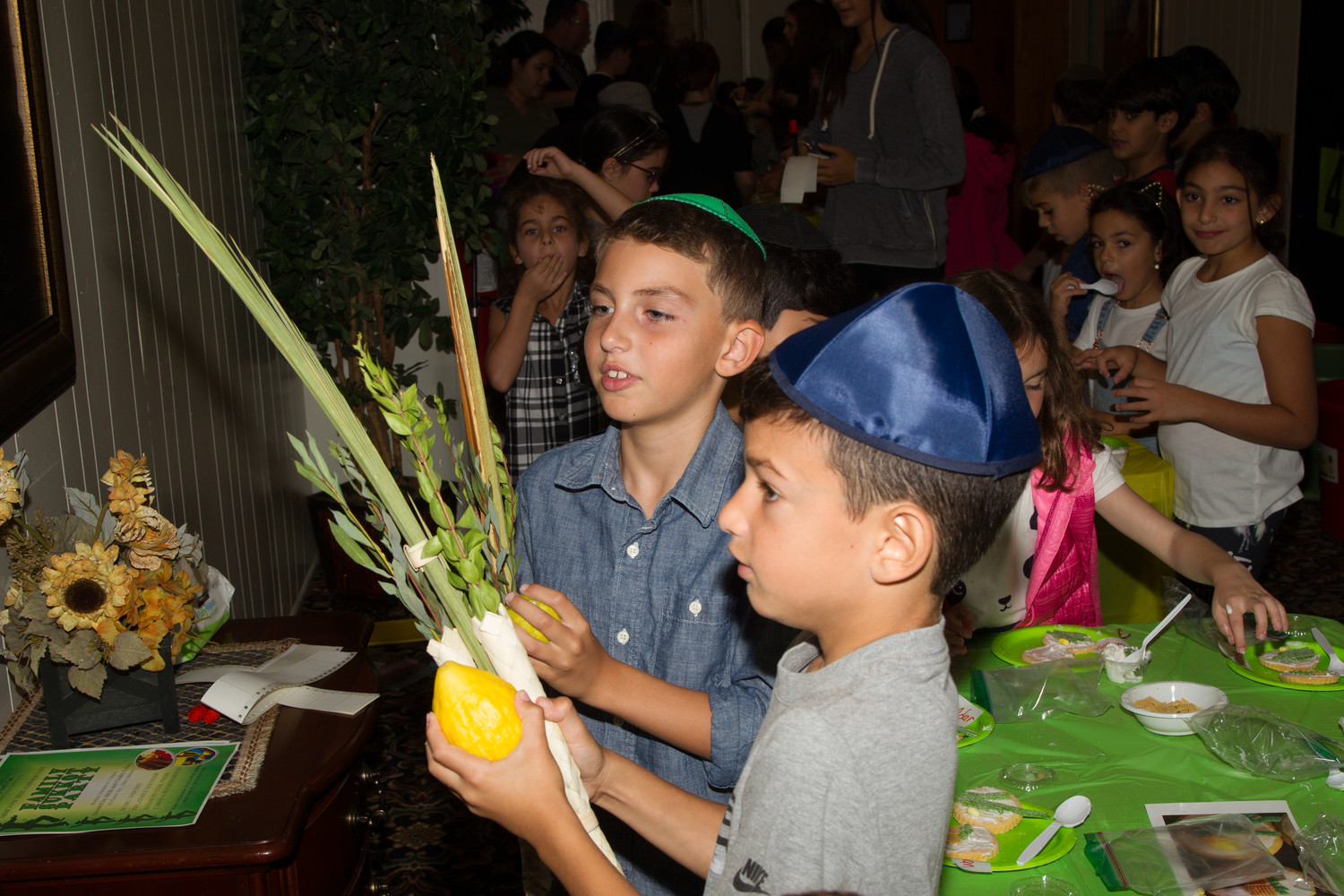 Sunday school students from the Chabad ceremoniously shook the lulav and etrog three times.