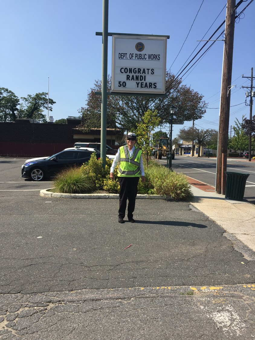 Randi Dyrvic, 87, retired on Sept. 29 after 50 years as a crossing guard. Lynbrook's Department of Public Works, which is headquartered near her post at the intersection of Merrick Road and Taft Avenue, congratulated her with a sign on her last day.