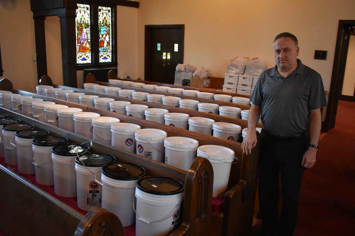 The Rev. Scott Ressman of the United Church of Rockville Centre volunteered his church as a drop-off location for Church World Service, which is gathering buckets filled with emergency supplies.