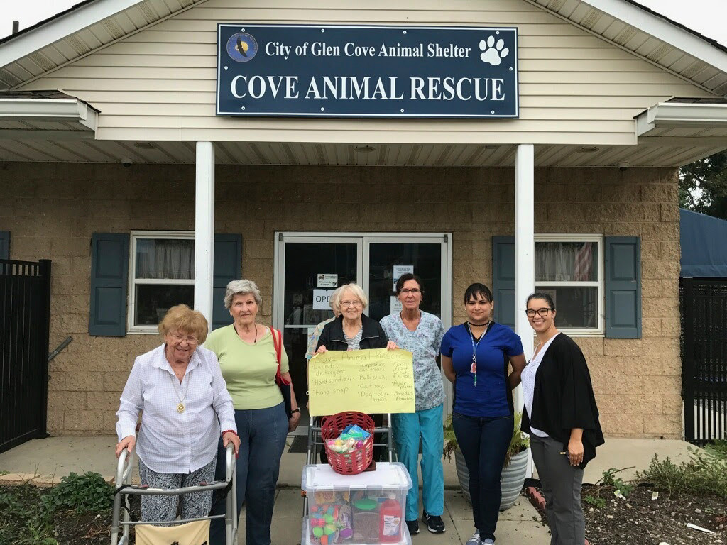 Staff at the Cove Animal Rescue were touched by the Atria Glen Cove's donation of wish list supplies for their resident cats and dogs. Atria residents Gloria Panaro, left, Jane Pomroy and Elsa Koob delivered the donations to Cove Animal Rescue employees Rita Jorgenson and Marilyn Murillo, with the help of Atria Engage Life Director Ashley Katon-Donegal.