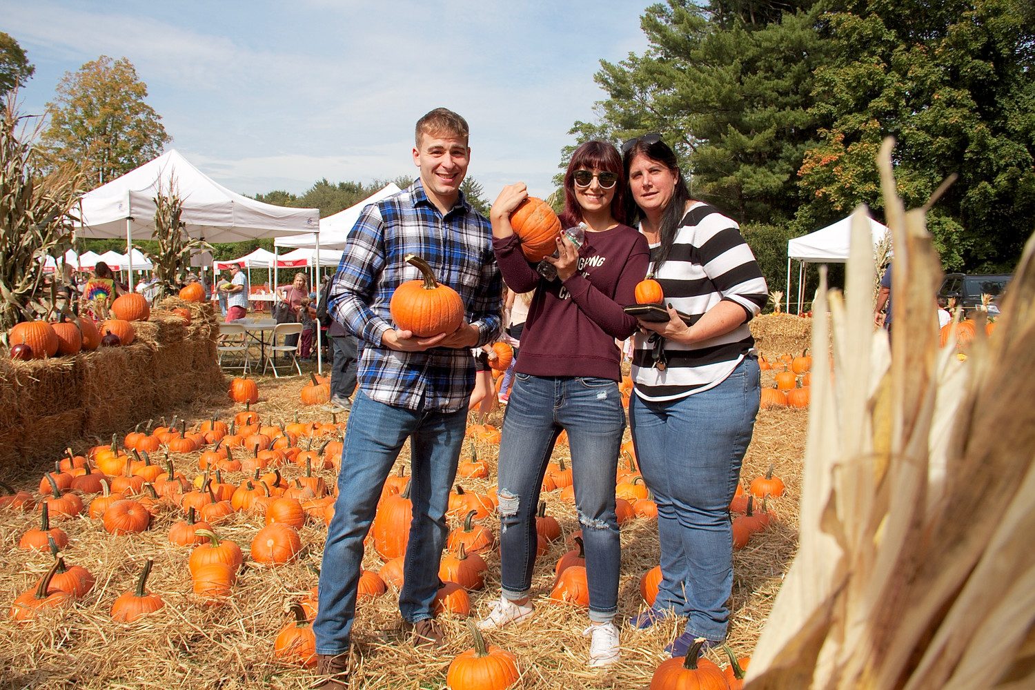 John Beers, Casie Strohson, and Suzanne Bower chose just the right pumpkins for themselves.
